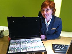 Jill Alexander with a briefcase of Polish zloty